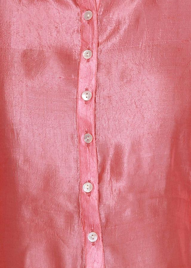 Peach kurti highlighted in placket only on Kalki
