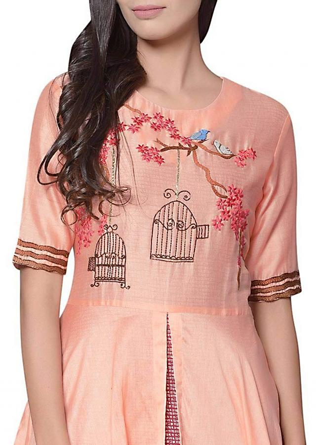 Peach kurti in cotton embellisehd in cage and bird motif
