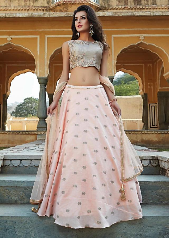 Peach lehenga in raw silk with contrast blouse in french knot and kundan embroidery only on Kalki
