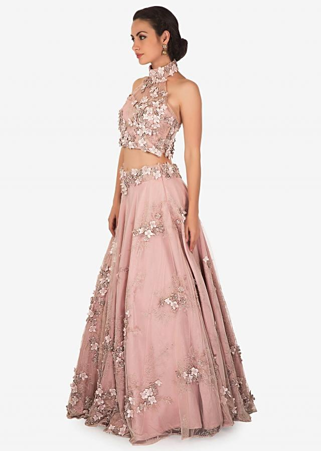 Peach lehenga matched with crop top blouse in 3D flower embroidery only on Kalki