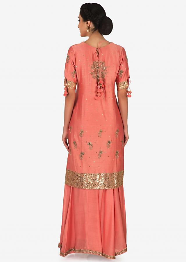 Peach palazzo suit with pista green dupatta adorn in zardosi and sequin work only on Kalki