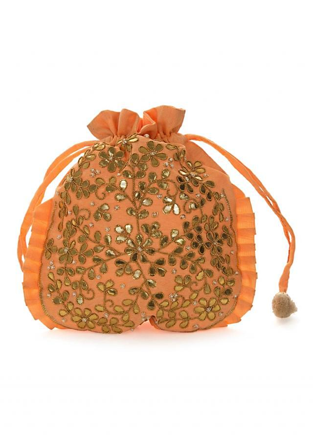 Peach potli bag beautified in gotta patti embroidered work only on Kalki