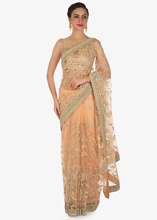Peach saree in cod and resham floral embroidery in net only on Kalki