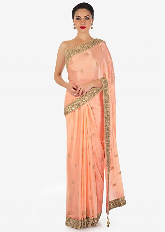 Peach saree in satin chiffon with thread work and gotta patch border only on Kalki