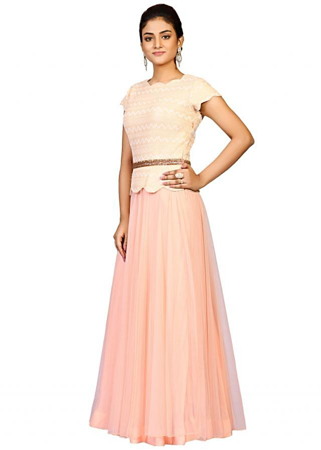 Peach scallop lace gown in net embellished in beautiful fancy self embroidery only on Kalki