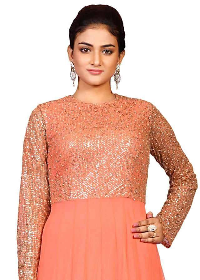 Peach Sequin yoke gown in net enhanced in detailed sequin embroidery only on Kalki