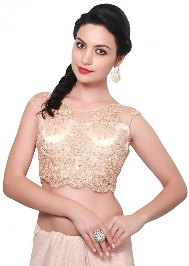 Peach shimmer saree matched with embroidered blouse only on Kalki
