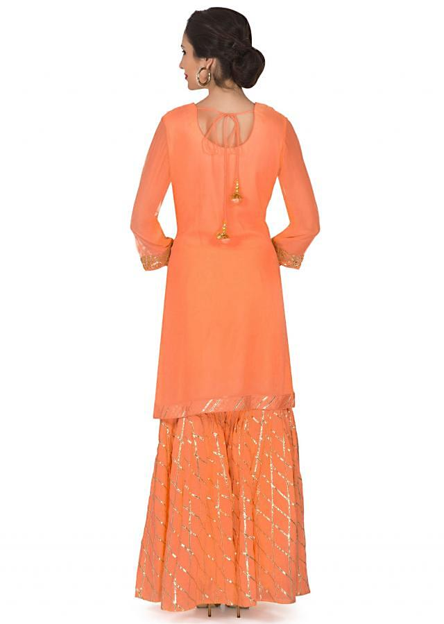 Peach straight palazzo suit embellished in gotta patch embroidery only on Kalki