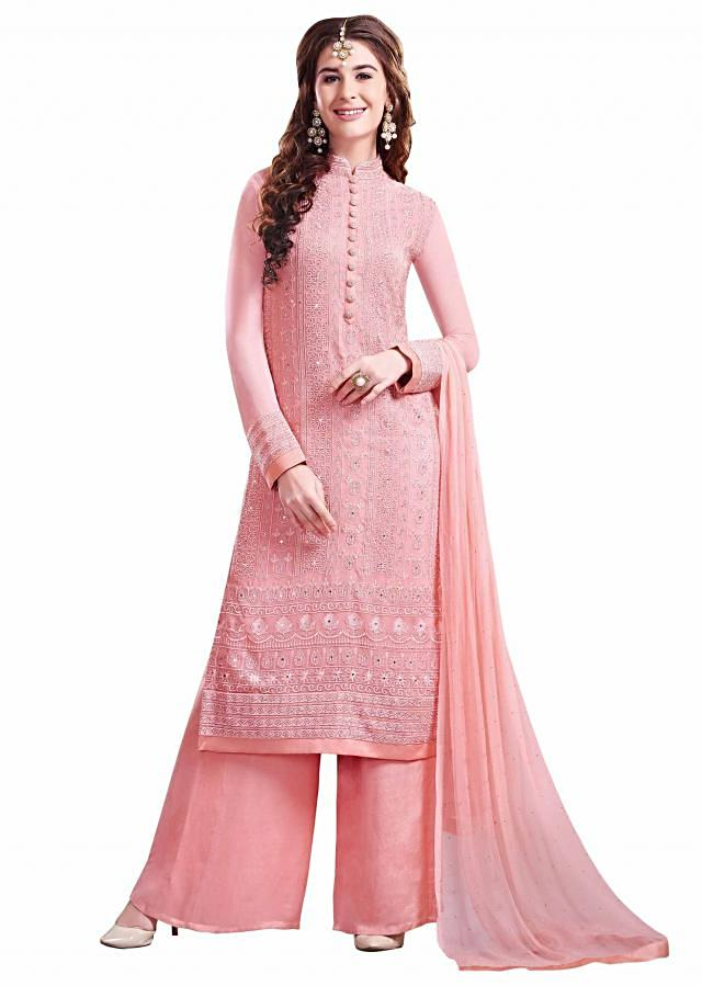 Peach unstitched suit adorn in resham and kundan embroidery