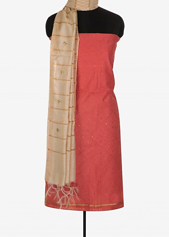 Peach unstitched suit beautified with thread work only on Kalki