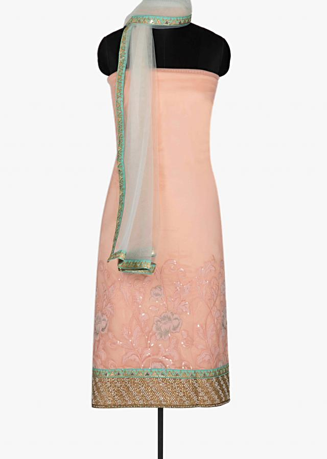 Peach unstitched suit in embroidered net with pearl border only on Kalki