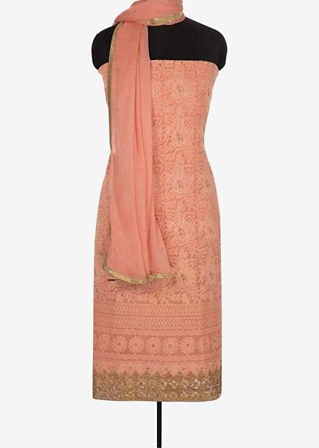 Peach unstitched suit in georgette crafted in cut dana and lucknowi thread work only on Kalki