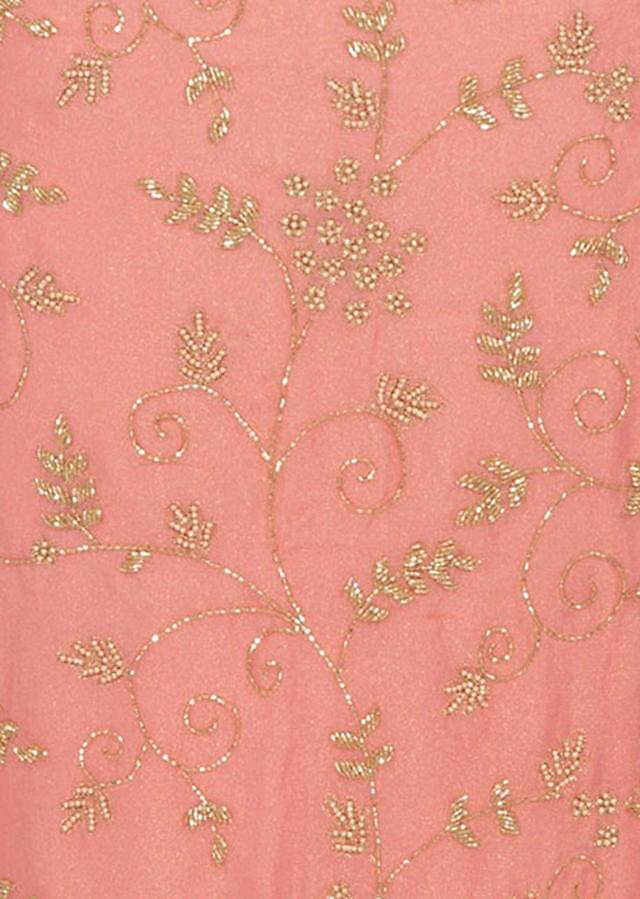 Peach unstitched suit in shimmer georgette embellished in moti and cut dana work only on Kalki