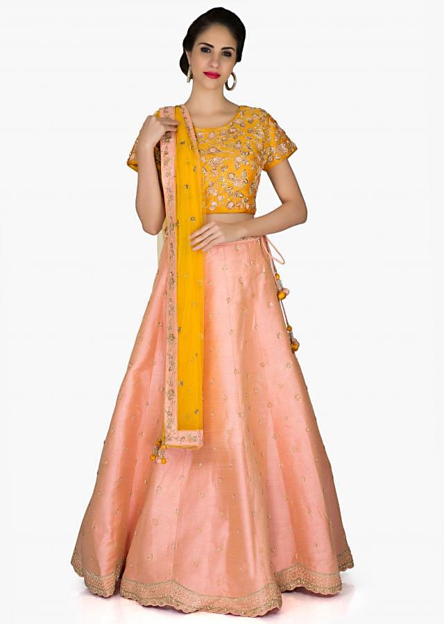Peach Yellow Silk Lehenga Blouse Ensemble Styled with Embroidered Patterns only on Kalki