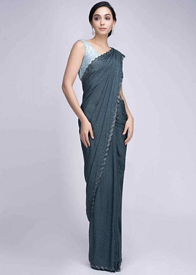 Peacock blue crepe saree with cut dana scallop embroidered border only on Kalki