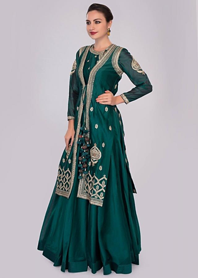 Peacock blue skirt and blouse paired with matching only on Kalki