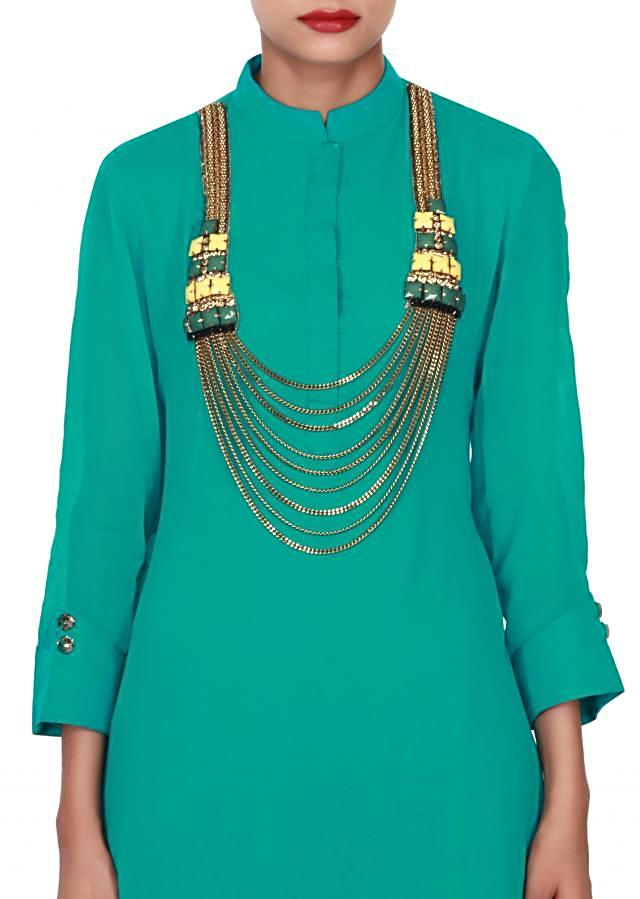 Peacock green kurti adorn in fancy neckline only on Kalki