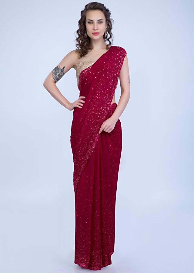 Pearls and sequins studded cherry red crepe saree only on Kalki