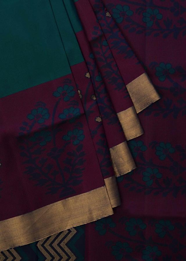 Peocock green and pink saree in silk beautified in weaved embroidery only on Kalki