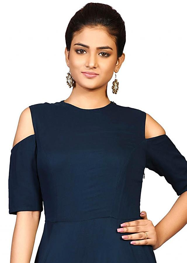 Petrol blue Persian buta gown in georgette featuring the beautiful zari embroidery only on Kalki