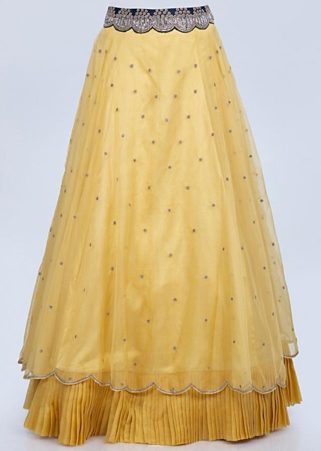Pine yellow organza lehenga and dupatta with mid night blue embroidered raw silk blouse only on Kalki