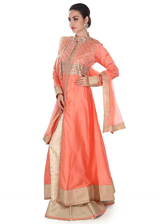 Pink A line top with cream lehenga only on Kalki