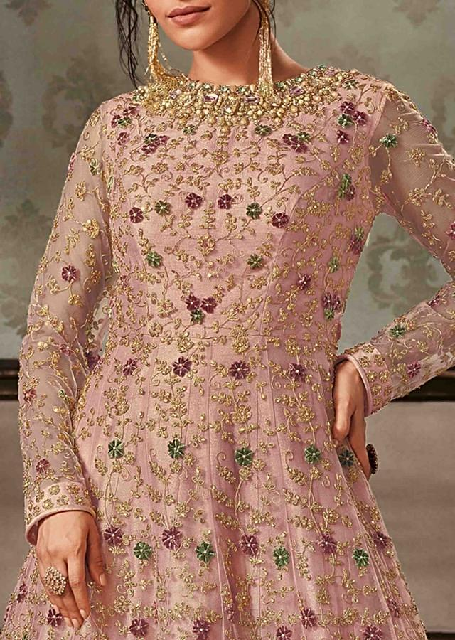 Pink anarkali gown featuring in net with stone embroidered neckline