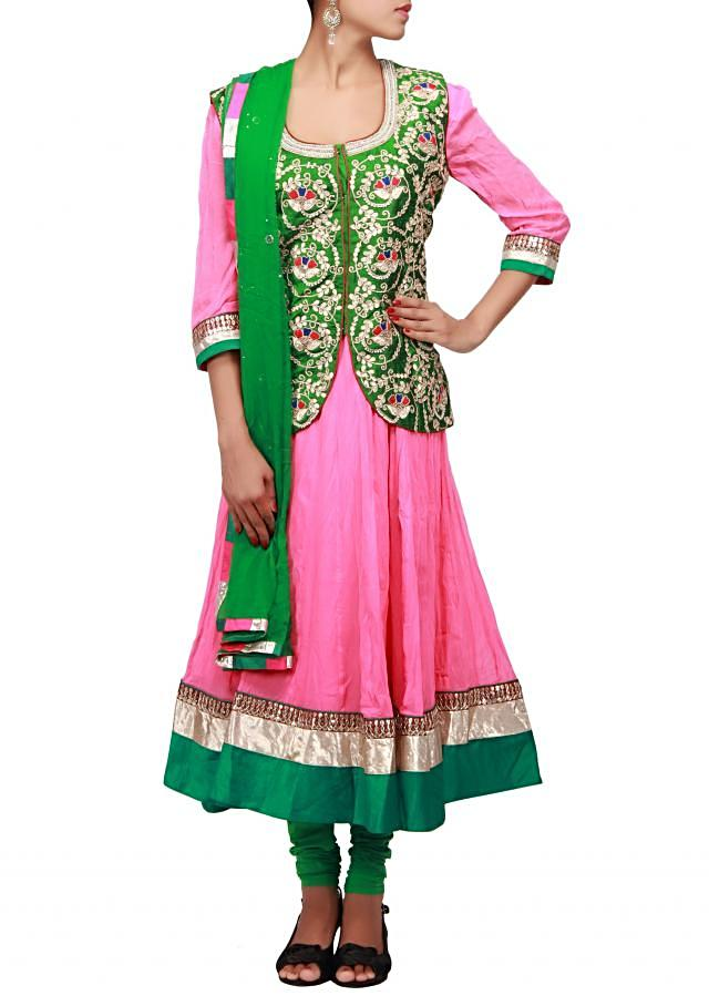 Pink anarkali suit matched with green embroidered jacket only on Kalki