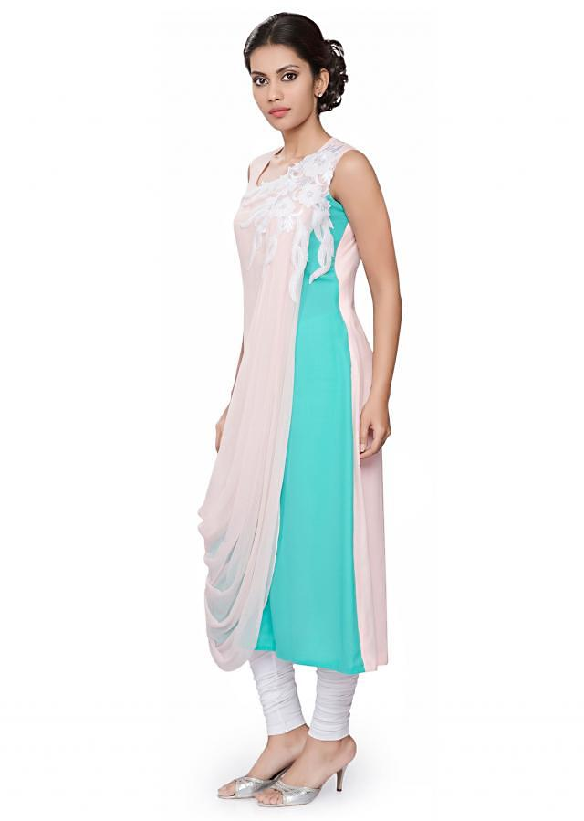 pink and blue draped tunic with white embroidery on drape