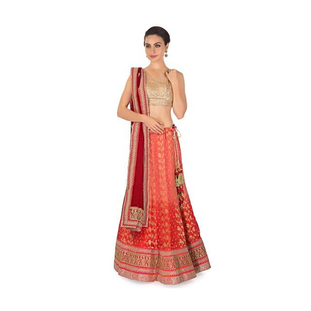 pink and coral shaded lehenga matched with a coral brocade blouse and georgette lace dupatta only on kalki