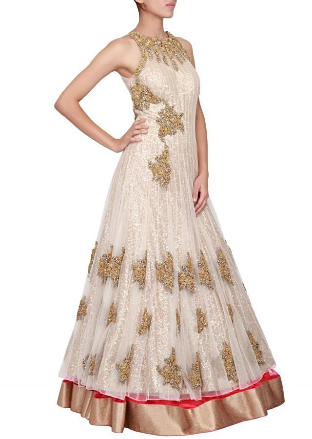 Pink and cream net jacket lehenga in net embellished in french knot only on Kalki