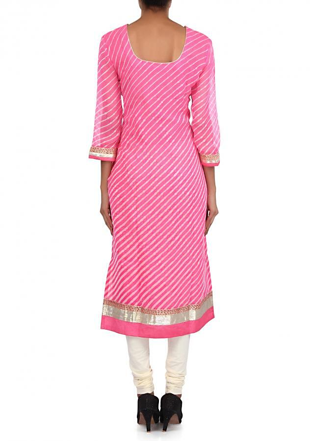 Pink and cream suit adorn in zari and pleat embroidery only on Kalki
