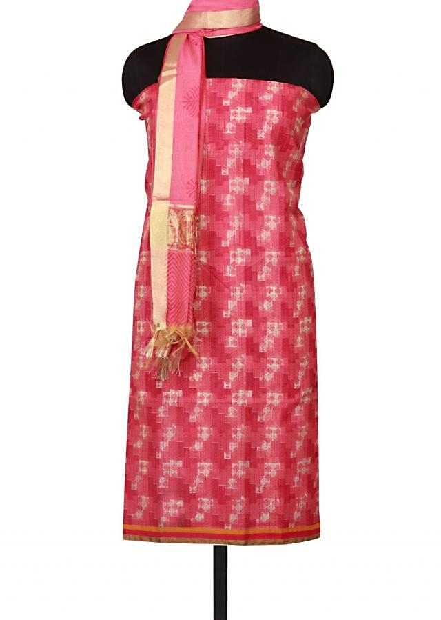 Pink and cream unstitched suit enhanced in self print only on Kalki