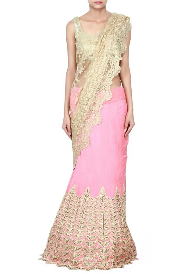 Golden pink  lehenga saree featuring in zari and sequin embroidery only on Kalki