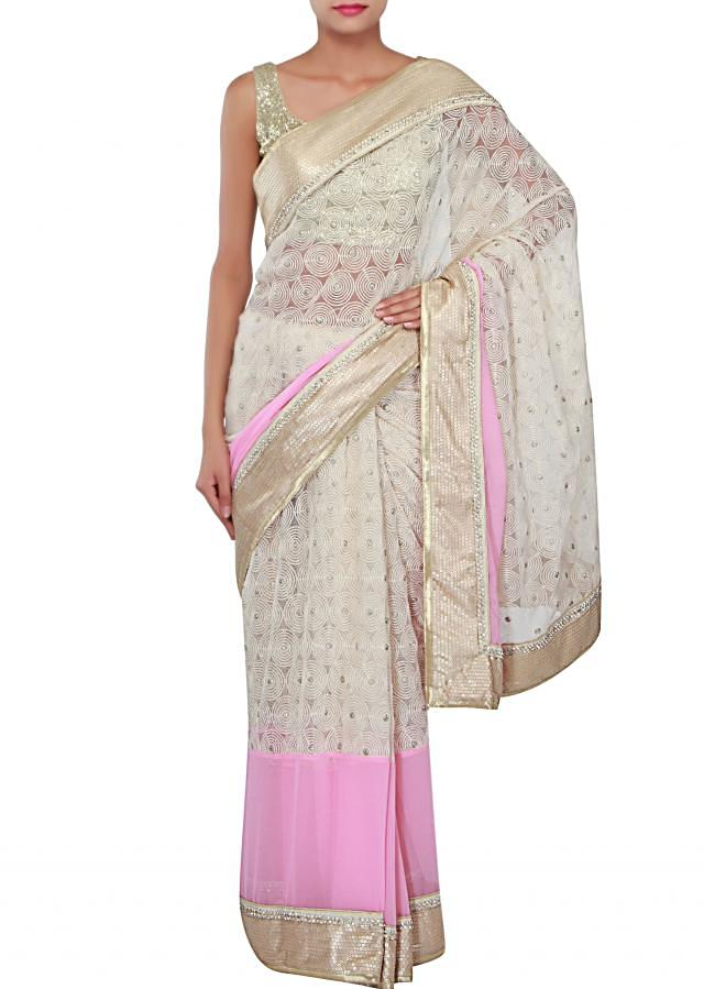 Pink and off white saree adorn in thread and sequin embroidery only on Kalki