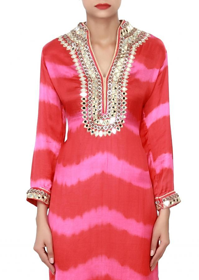 Pink and red kurti adorn in mirror and fancy buttons only on Kalki