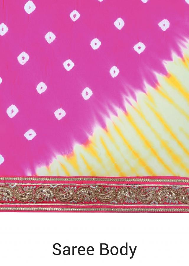 Pink and yellow bandhani saree enhanced in embroidered border only on Kalki