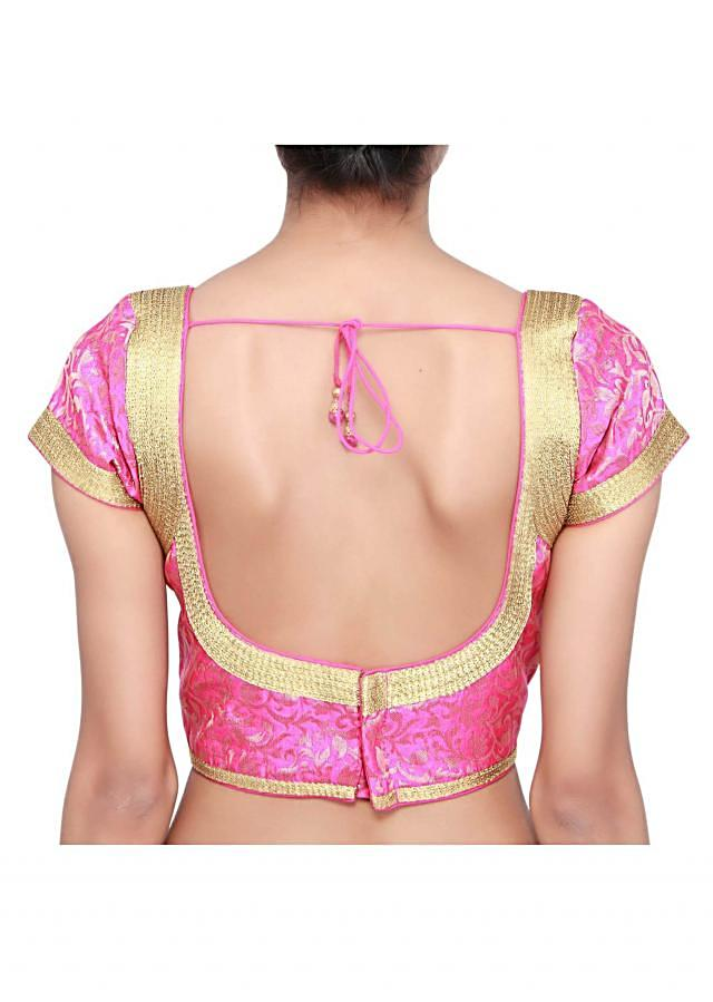 Pink blouse adorn in golden zari lace only on Kalki