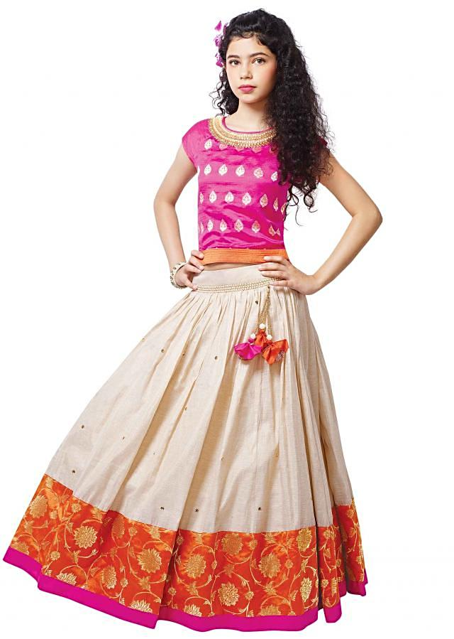 Pink brocade blouse matched with cream lehenga