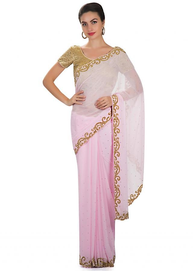 Pink georgette saree adorned with cut dana embroidery only at Kalki