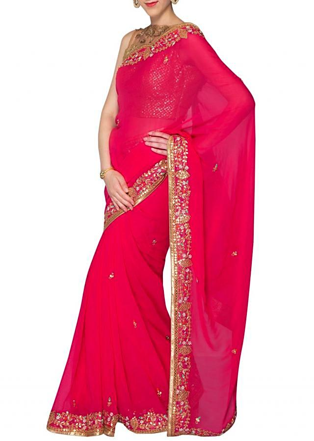 Pink georgette saree adorned with gotta patch work only on Kalki