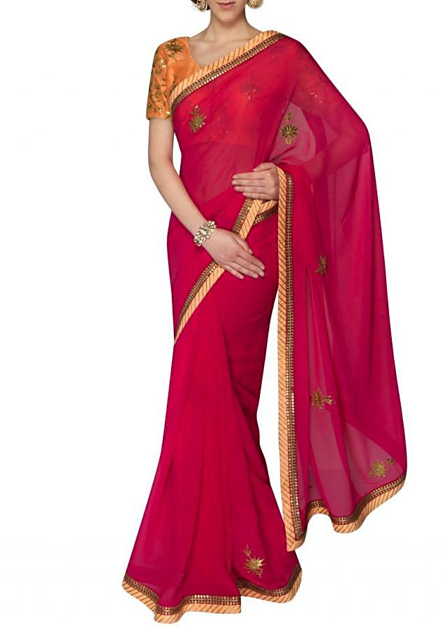 Pink georgette saree crafted with gotta patch work only on Kalki