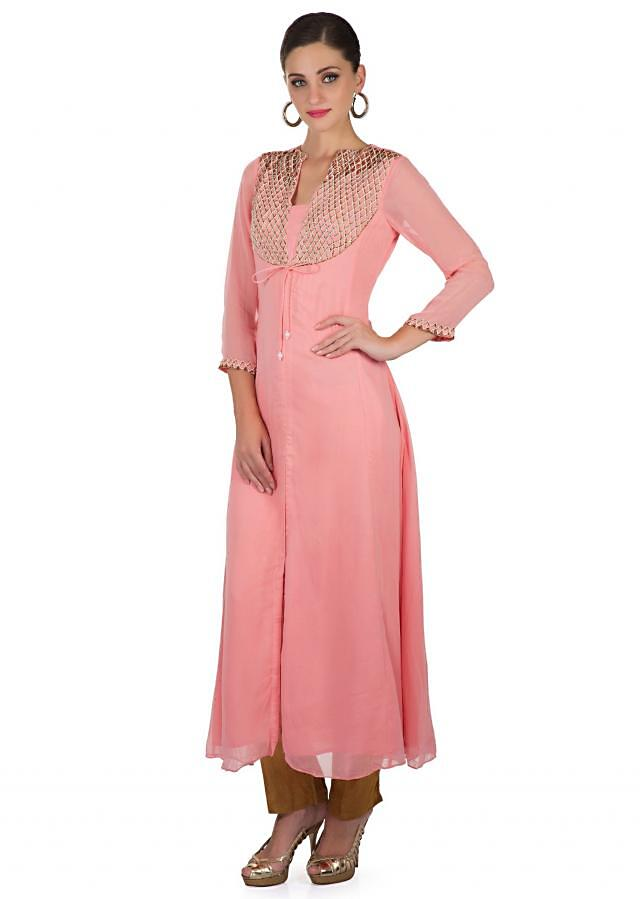 Pink Georgette Top Featuring Zardosi and String Tie Up Pattern Accompanied by Muted Gold Cotton Pants only on Kalki