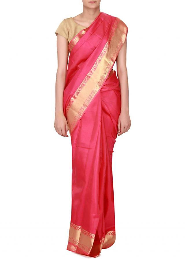 Pink green silk saree enhanced in weave embroidery only on Kalki