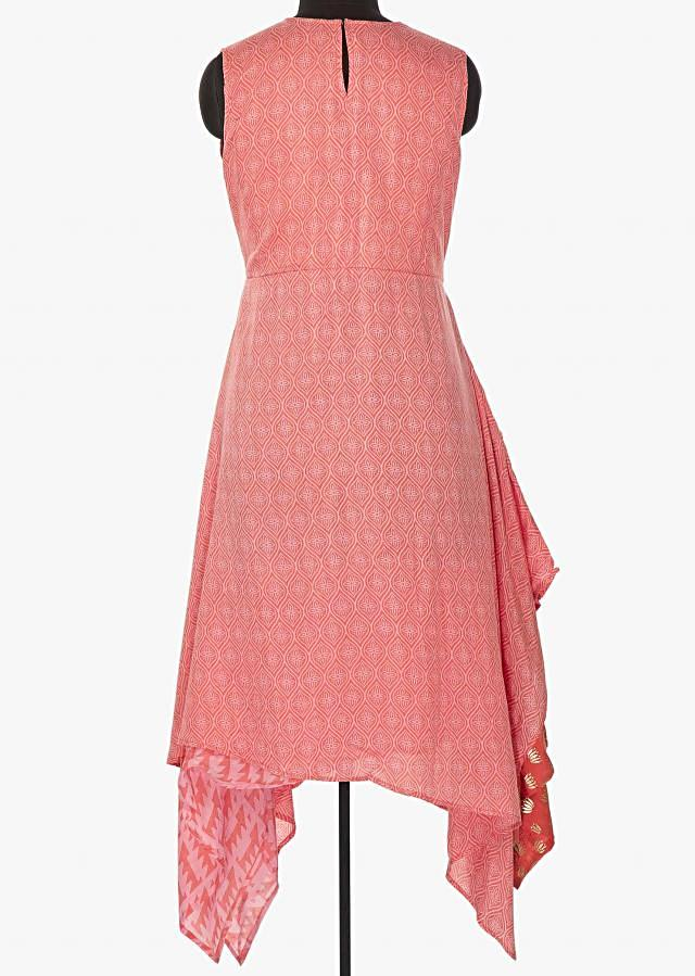 Pink kurti with handkerchief hem line and fancy tassel only on Kalki