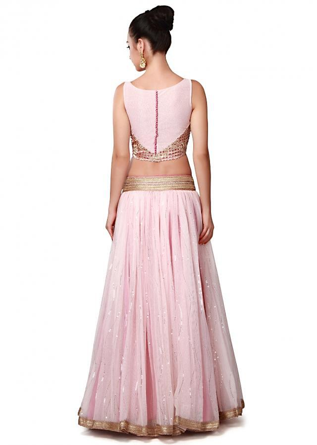 Pink lehenga enhanced in lace embroidery only on Kalki