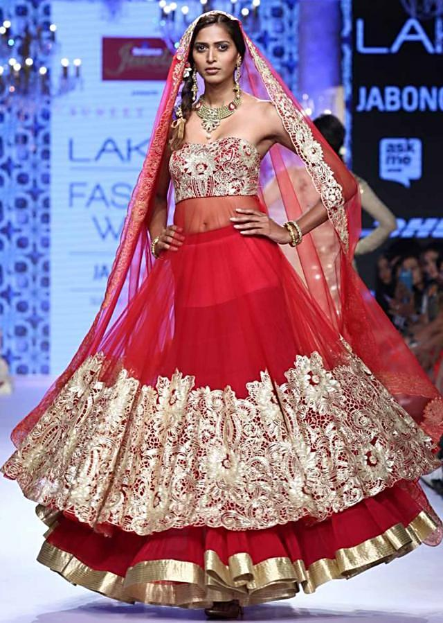 Model walks the ramp in pink lehenga with red long blouse adorn in cut work embroidery for Suneet Verma for his collection Decorative Arts of India at Lakme Fashion Week Summer Resort 2015