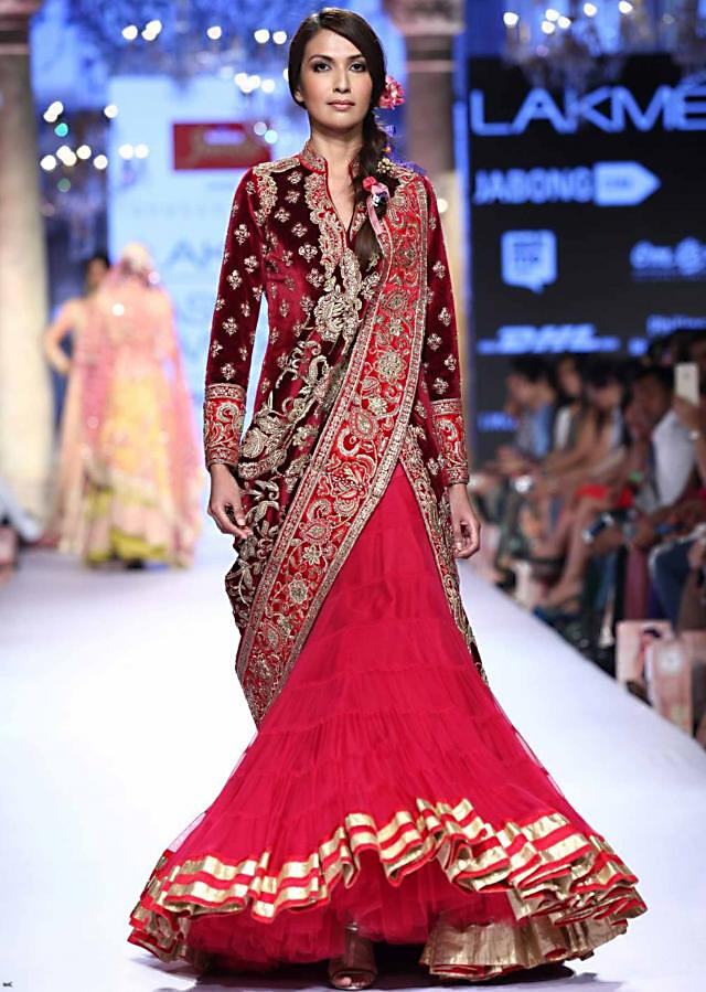 Model walks the ramp in pink lehenga with velvet embroidered blouse for Suneet Verma for his collection Decorative Arts of India at Lakme Fashion Week Summer Resort 2015