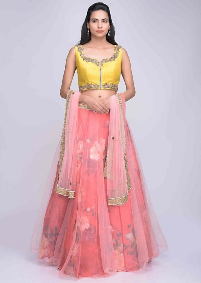 Pink net lehenga with red printed organza under layer and pink net dupatta only on Kalki