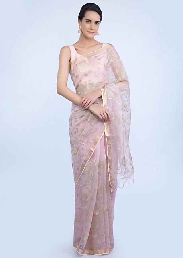 Pink organza saree embellished in zari floral jaal embroidery only on Kalki